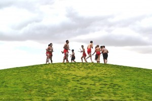 Aboriginal boys dance on the Grassy Knoll, Victoria Park Lake, Shepparton.