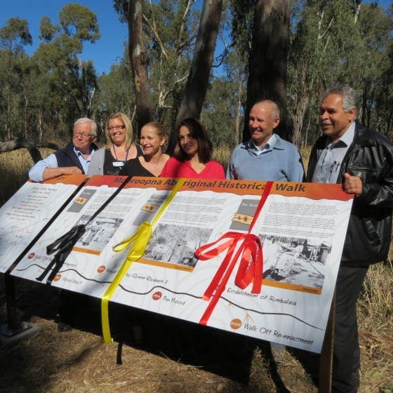 Partners and staff with The Flats Interpretive signage